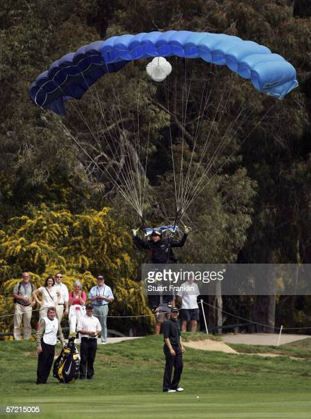A skydiver lands on the fifth fairway infront of David Park of Wales and Robert Coles of England during the first round of The Algarve Open de...