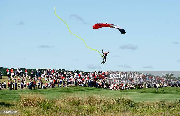 A skydiver lands on the first fairway during the Sunday singles matches at the 2009 Solheim Cup at Rich Harvest Farms on August 23 2009 in Sugar...