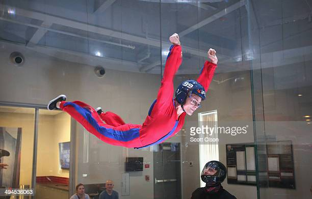 Skydiver Lauren Wilkerson practices wind tunnel flying at the iFly indoor skydiving facility on May 29 2014 in Rosemont Illinois Guests at the...