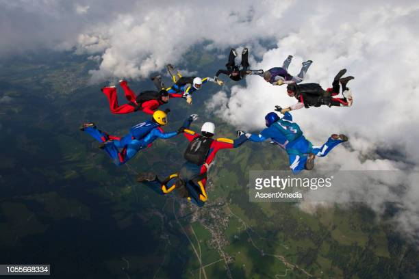skydivers fall towards the earth - trust stock pictures, royalty-free photos & images