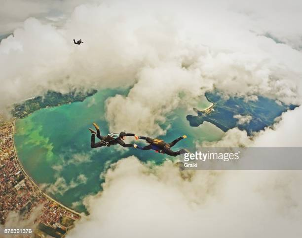 skydivers falling among the clouds - fallen soldier stock pictures, royalty-free photos & images