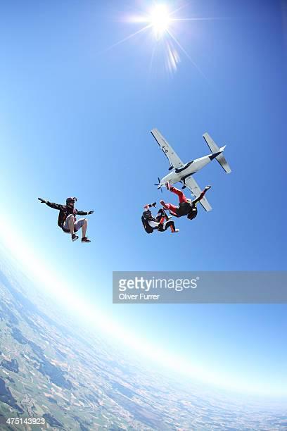 Skydivers free falling above Leutkirch, Bavaria, Germany