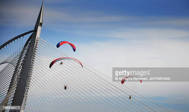skydivers in putrajaya - putrajaya stock photos and pictures