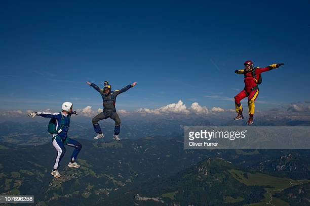 Skydivers in sit position having fun together.
