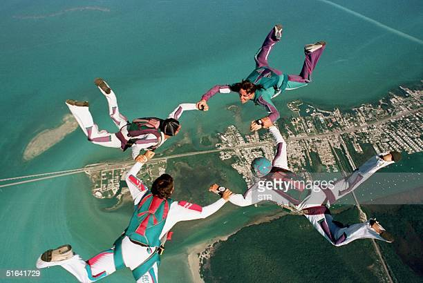 Skydivers perform their routines over Marathon and the Seven Mile Bridge in the Florida Keys 12 December, during the beginning of the three-day...
