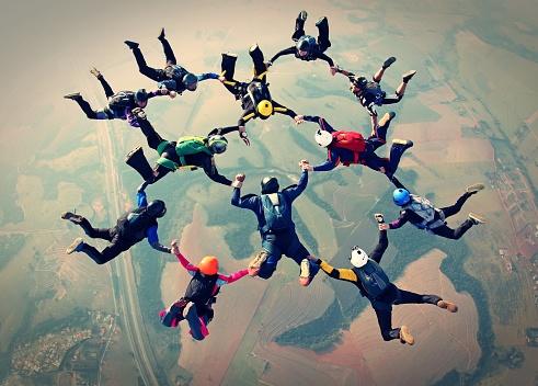 Skydivers team work photo effect 1064255538