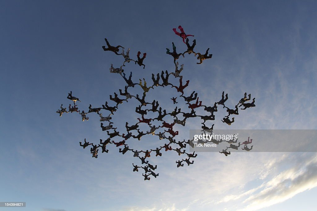 82 skydivers in formation.