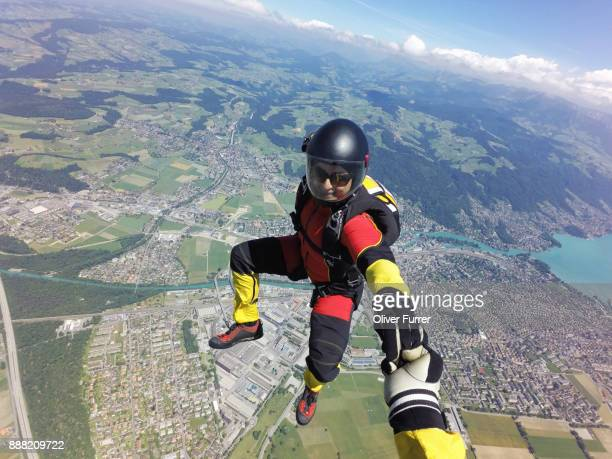 this skydiver is sit flying with