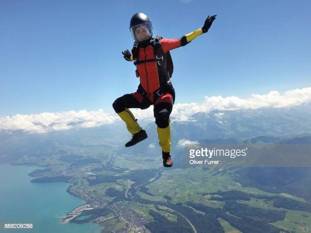 this skydiver girl is sit flying