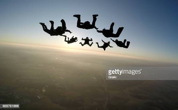 Skydiving group at the sunset