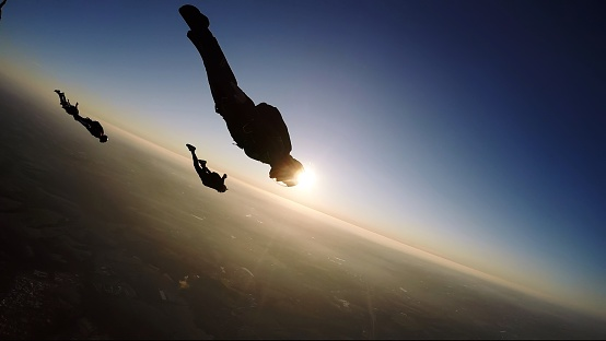 Skydiving group at the sunset - gettyimageskorea