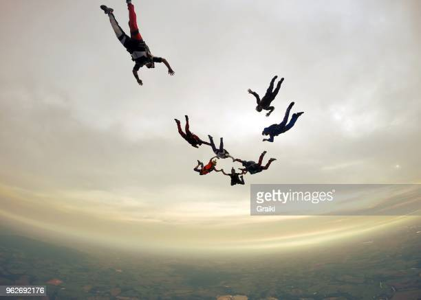 skydiving group cloudy day - arrangement stock pictures, royalty-free photos & images