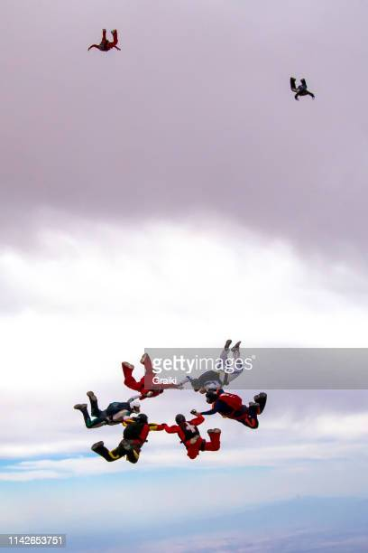 skydiving group formation - free business coaching stock pictures, royalty-free photos & images