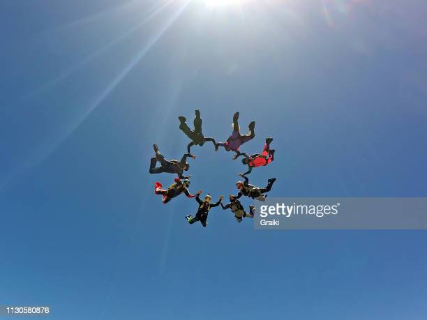 skydiving group having fun - sportkleding stock pictures, royalty-free photos & images