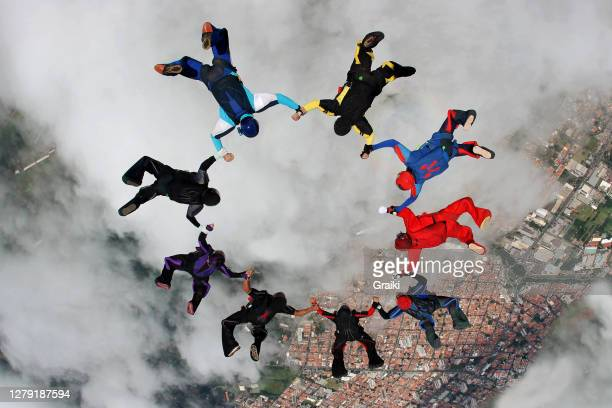 skydiving group up side down macking a star - sports team stock pictures, royalty-free photos & images