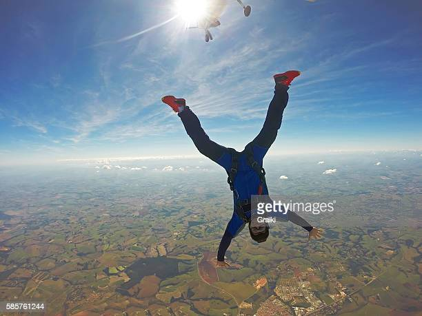 skydiving head down man - letter x stock pictures, royalty-free photos & images