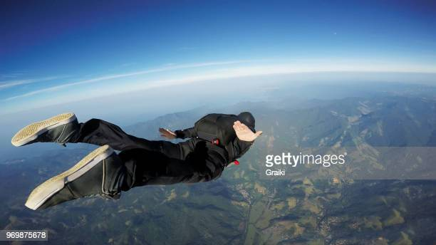 skydiving man jumping over the sea at a sunrise - leap day stock pictures, royalty-free photos & images