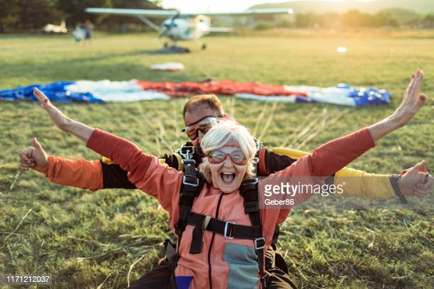 skydiving - active seniors stock pictures, royalty-free photos & images