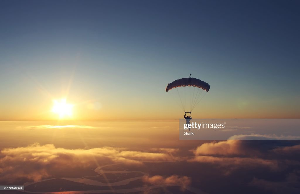 Skydiving sunset : Stock Photo