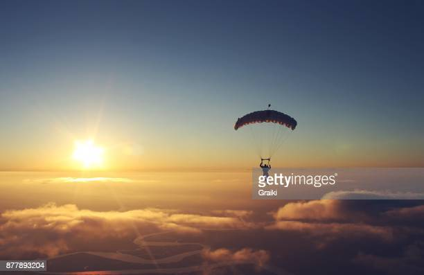 skydiving sunset - majestic stock pictures, royalty-free photos & images