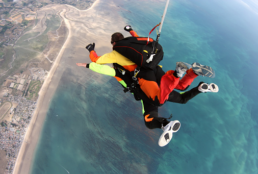 Skydiving tandem above the beach - gettyimageskorea