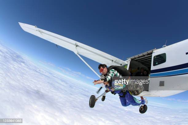 skydiving tandem above the clouds - diving to the ground stock pictures, royalty-free photos & images