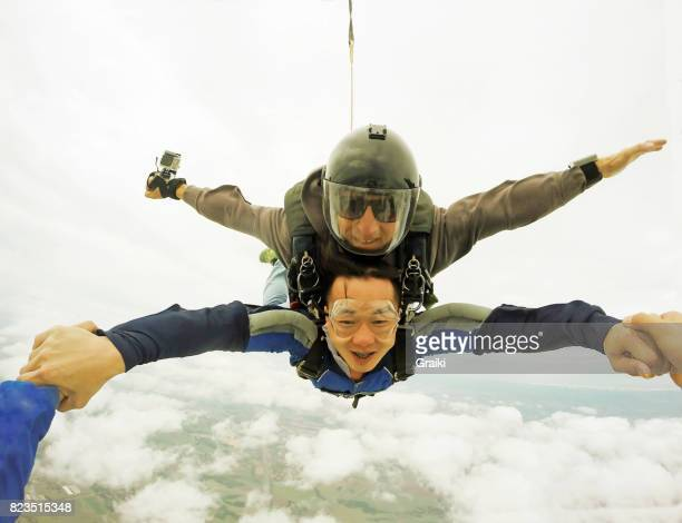 Skydiving tandem asian man