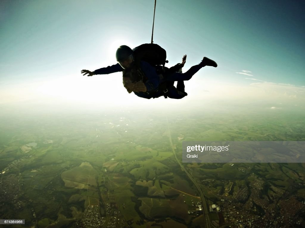 Skydiving tandem silhouette effect : Stock Photo
