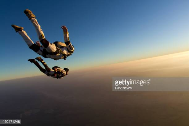 skydiving track sunset - extreme sports stock pictures, royalty-free photos & images