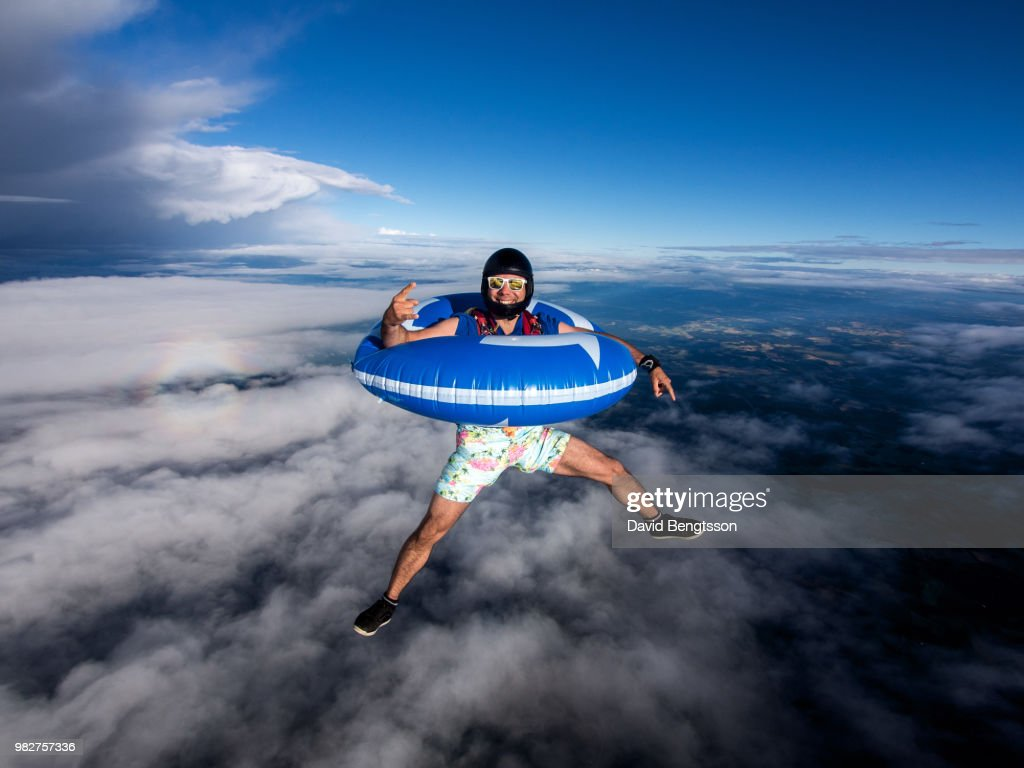 Skydiving with swimming ring, Stockholm, Sweden : Stock Photo