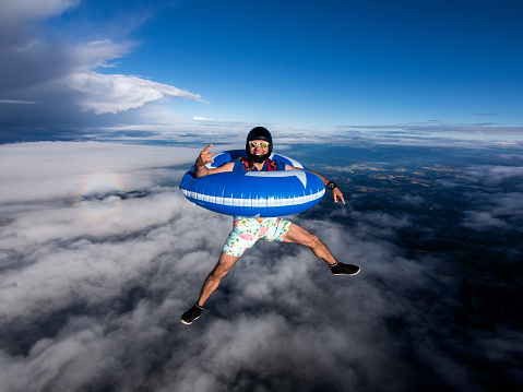 Skydiving with swimming ring, Stockholm, Sweden - gettyimageskorea