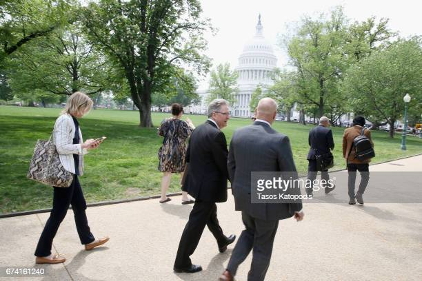 Skye Raiser President of the Environmental Working Group Ken Cook and Celebrity Chef Tom Colicchio walk to the Capitol building to meet with...