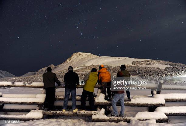 Sky-gazers take in the view from Chugach State Park during the lunar eclipse late Monday, December 20, 2010.