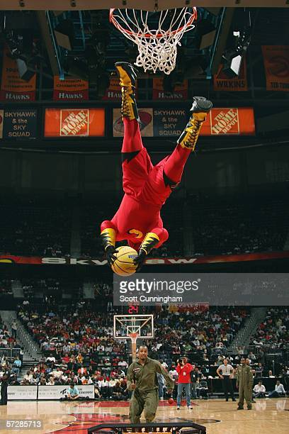 Skyhawk dunks as he entertains during a timeout in a game between the Atlanta Hawks and the Washington Wizards on April 7 2006 at Philips Arena in...