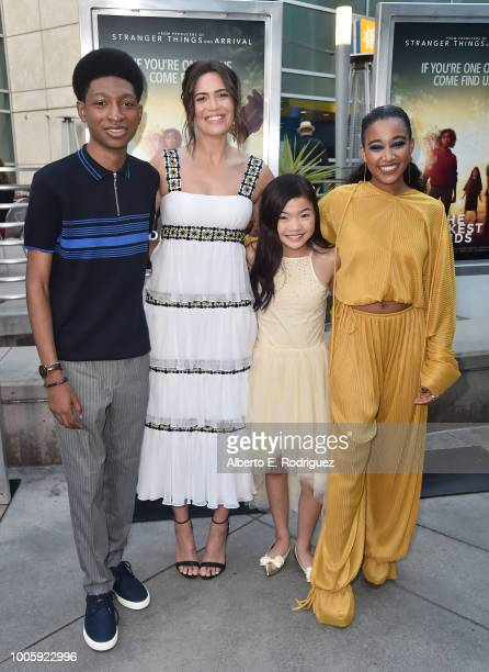 Skylan Brooks Mandy Moore Miya Cech and Amandla Stenberg attend a screening of 20th Century Fox's Darkest Minds at ArcLight Hollywood on July 26 2018...