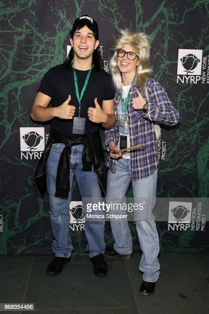 Skylar Astin and Anna Camp attend Bette Midler's 2017 Hulaween event benefiting the New York Restoration Project at Cathedral of St John the Divine...