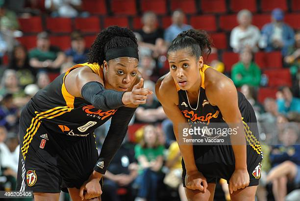 Skylar Diggins and Odyssey Sims of the Tulsa Shock during the game on June 12014 at Key Arena in Seattle Washington NOTE TO USER User expressly...