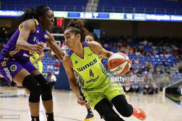Skylar Diggins of the Dallas Wings handles the ball against Nneka Ogwumike of the Los Angeles Sparks during a WNBA basketball game at College Park...
