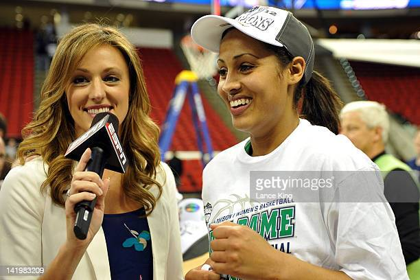 Skylar Diggins of the Notre Dame Fighting Irish celebrates following their win against the Maryland Terrapins as ESPN sideline reporter Allison...