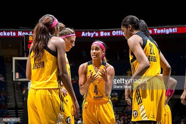 Skylar Diggins of the Tulsa Shock huddles with teammates against the Atlanta Dream during the WNBA game on July 29 2014 at the BOK Center in Tulsa...