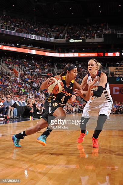 Skylar Diggins of the Western Conference AllStars dribbles against Katie Douglas of the Eastern Conference AllStars during the 2014 Boost Mobile WNBA...