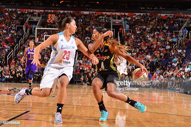 Skylar Diggins of the Western Conference AllStars dribbles against Shoni Schimmel of the Eastern Conference AllStars during the 2014 Boost Mobile...