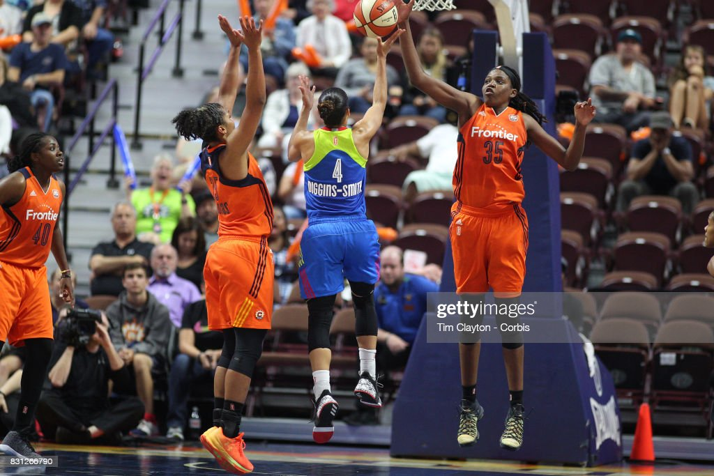 Skylar Diggins-Smith #4 of the Dallas Wings has her shot blocked by Jonquel Jones #35 of the Connecticut Sun during the Connecticut Sun Vs Dallas Wings, WNBA regular season game at Mohegan Sun Arena on August 12th, 2017 in Uncasville, Connecticut.