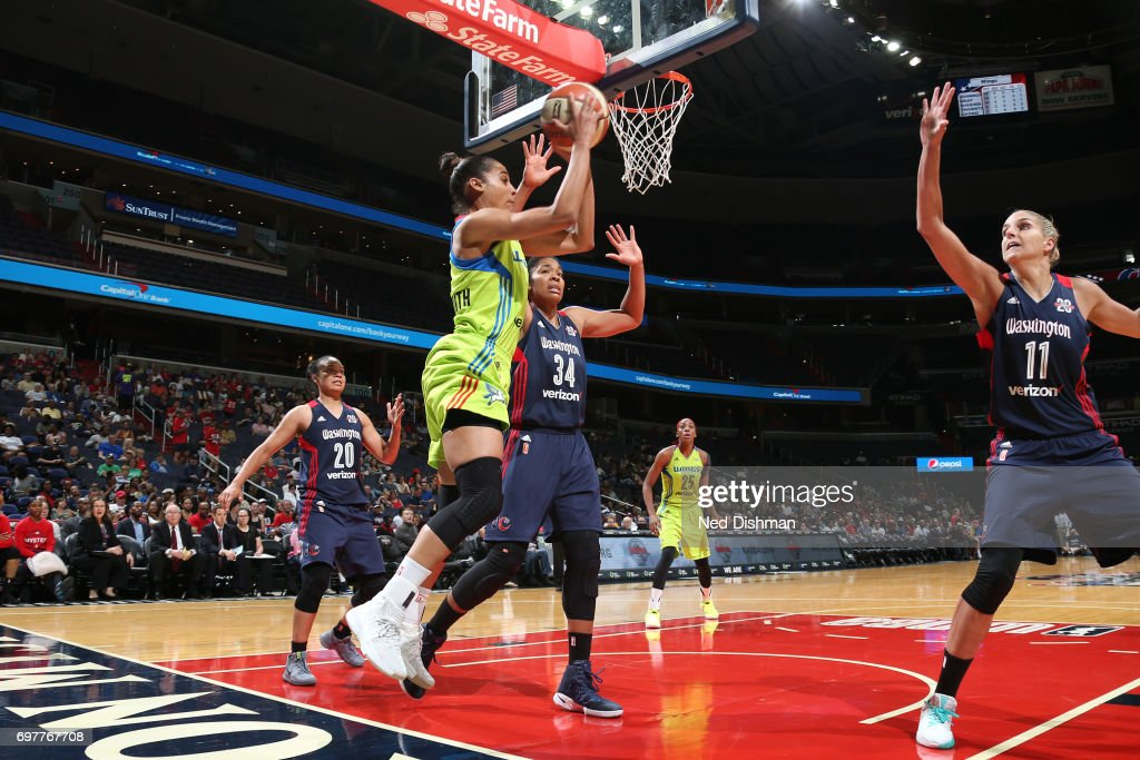 Skylar Diggins-Smith of the Dallas Wings looks to pass the ball against the Washington Mystics on June 18, 2017 at the Verizon Center in Washington, DC.