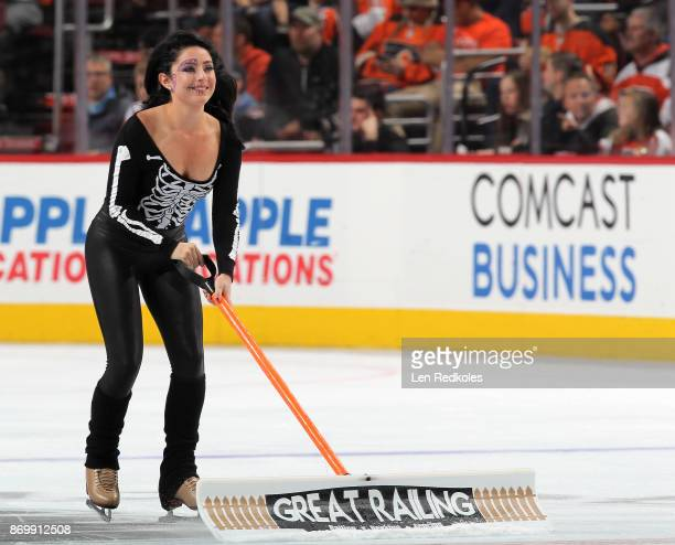 Skylar Grace of the Philadelphia Flyers ice girls dressed in a Halloween costume cleans the ice during a timeout against the Arizona Coyotes on...
