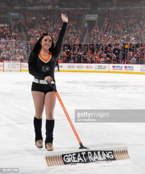 Skylar Grace of the Philadelphia Flyers ice girls waves to the crowd as she cleans the ice during a timeout against the New York Rangers on April 7...