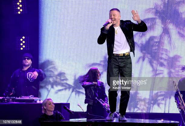 Skylar Grey and Macklemore perform onstage during Dick Clark's New Year's Rockin' Eve With Ryan Seacrest 2019 on December 31 2018 in Los Angeles...