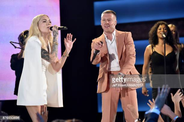 Skylar Grey and Macklemore perform onstage during the 2017 American Music Awards at Microsoft Theater on November 19 2017 in Los Angeles California