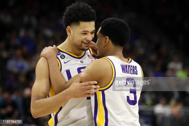 Skylar Mays and Tremont Waters of the LSU Tigers smile while talking before they take on the Maryland Terrapins during the second half of the game in...