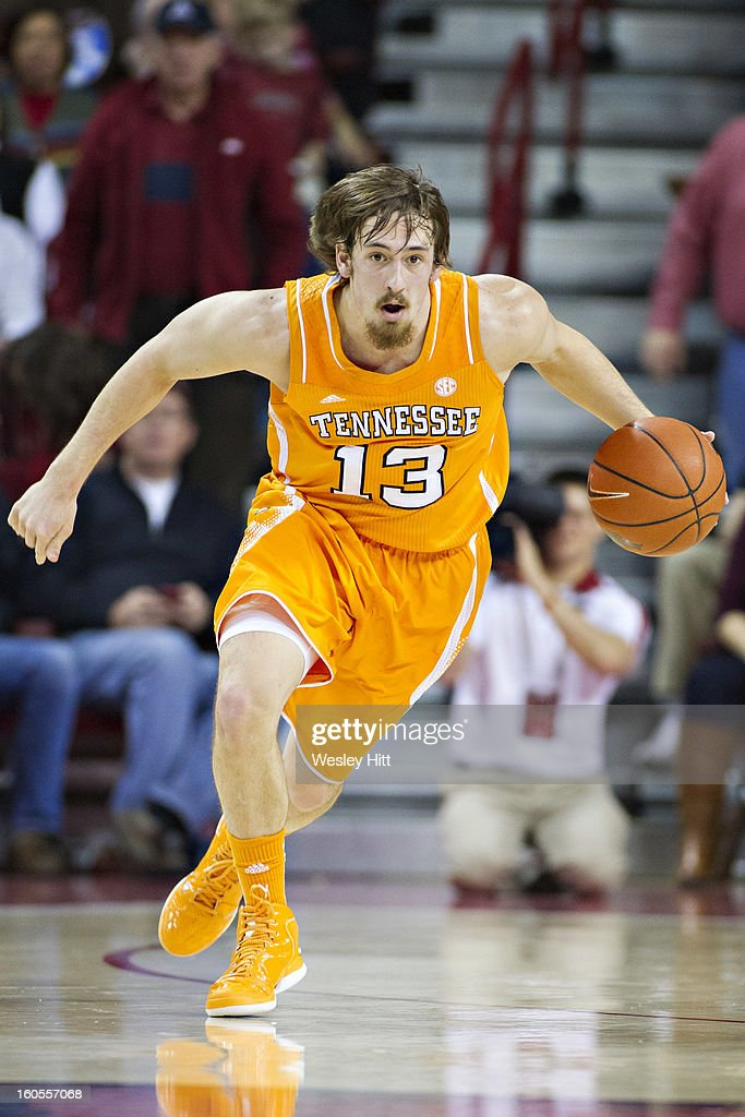 Skylar McBee #13 of the Tennessee Volunteers brings the ball down the floor against the Arkansas Razorbacks at Bud Walton Arena on February 2, 2013 in Fayetteville, Arkansas. The Razorbacks defeated the Volunteers 73-60.